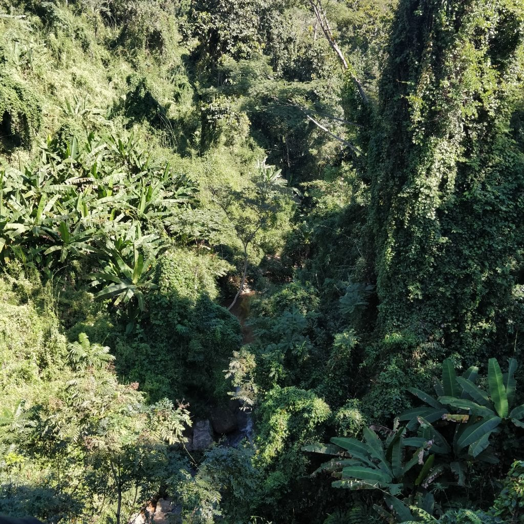 Over the small waterfall zip lining chiang mai