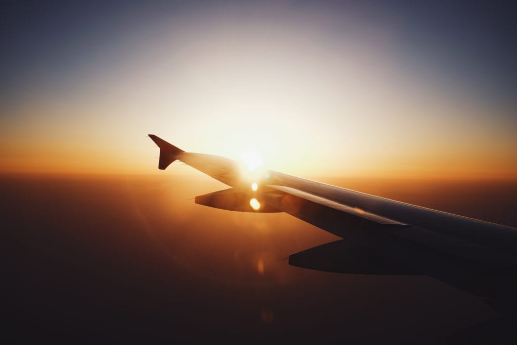 Plane wing by sunset